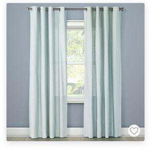 2 sets of Threshold light filtering curtains